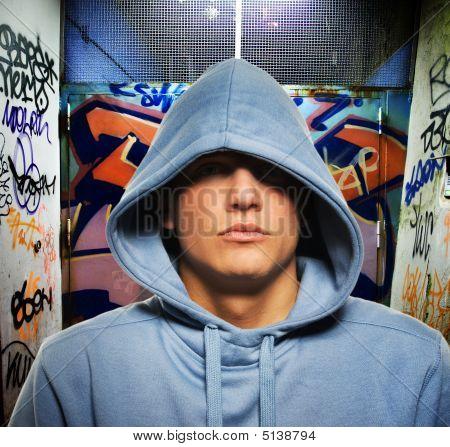 Cool Looking Hooligan In A Graffiti Painted Gateway