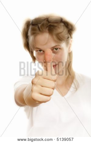 Girl Holds Her Thumb Finger Up