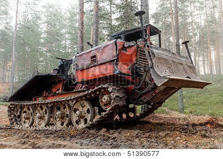 Experienced Rusty All-terrain Vehicle On Tracks