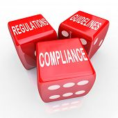 stock photo of ethics  - The words Compliance Regulations and Guidelines on three red dice to illustrate the need to follow rules and laws in conducting business - JPG