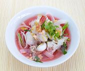 stock photo of wanton  - Photo of rice noodles in pink soup - JPG