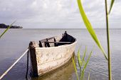 picture of sloop  - Old wooden fishing boat floating on sea water - JPG