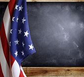 picture of democracy  - American flag in front of blackboard - JPG
