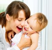 foto of hug  - Mother and Baby kissing and hugging at Home - JPG