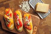 stock photo of collate  - Crostini small toasts with colored peppers and spices - JPG