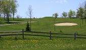 stock photo of split rail fence  - Early spring view of a well kept golf course in Wisconsin - JPG