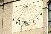 stock photo of sundial  - The photograph shows a sundial placed on the wall of the building - JPG