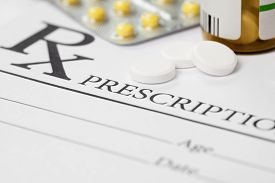 pic of overdose  - Medical prescription and several pills on table - JPG