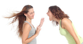 picture of shock awe  - Woman shouting angry to another one isolated on a white background - JPG