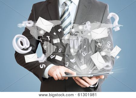 Man in suit holding tablet pc. Mailing concept