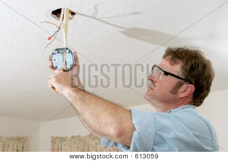 Electrician Wires Ceiling Box
