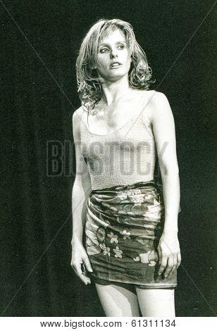 LODZ, POLAND - CIRCA 1980's: Vintage portrait of woman in mini shirt