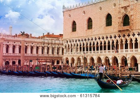 Gondolas And Gondolier In Front Of Ducale Museum