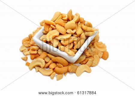 Halved Cashews In A Square White Bowl
