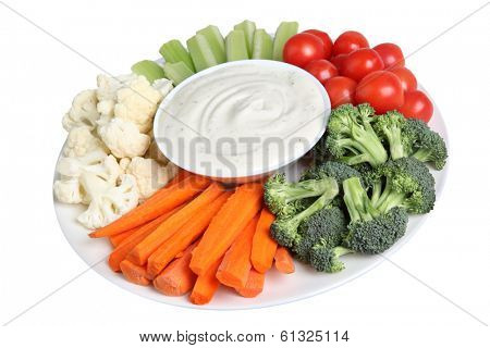 Vegetable tray with cauliflower, celery, tomatoes, broccoli, carrot sticks and ranch dip