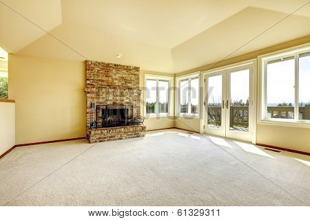 Empty Living Room With A Fireplace And Walkout Deck