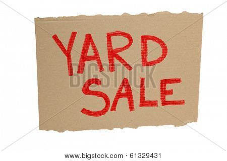 Cardboard yard sale sign on white background