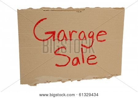 Cardboard Garage Sale sign on white background