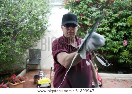 Window cleaner using a squeegee to wash a window.