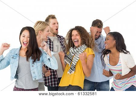Happy group of young friends cheering on white background