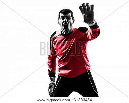 one caucasian soccer player goalkeeper man standing in silhouette isolated white background