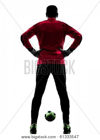 one caucasian soccer player goalkeeper man standing rear view in silhouette isolated white background