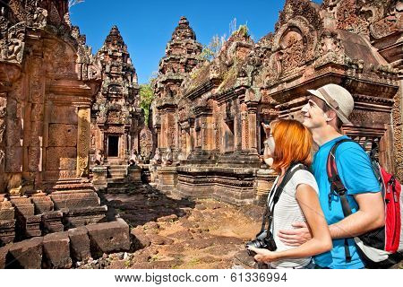 Beautiful young couple at Banteay Srei temple, caled temple of woman, in pink sandstone. Angkor wat complex, Cambodia.