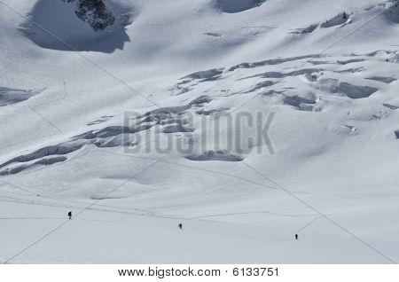 3 Skiers On A Glacier