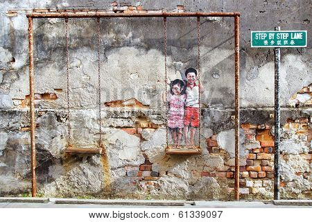 """Street Art """"Brother and sister on a swing"""". I"""