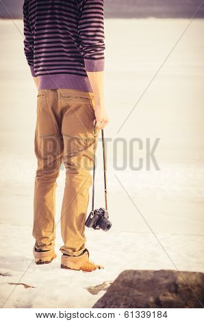 Young Man With Retro Photo Camera Outdoors