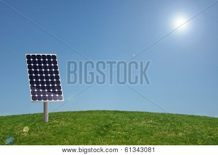Solar panel in grass with blue sky