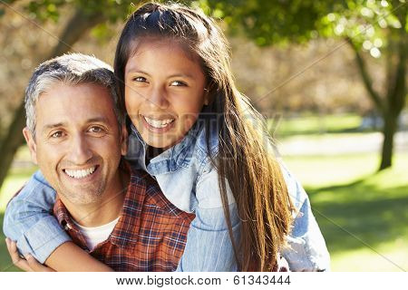 Portrait Of Father And Daughter In Countryside