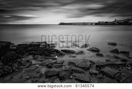 Long Exposure Black And White Seascape Landscape During Dramatic Evening In Winter