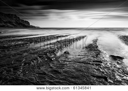Beautiful Black And White Landscape Of Rocky Shore At Sunset