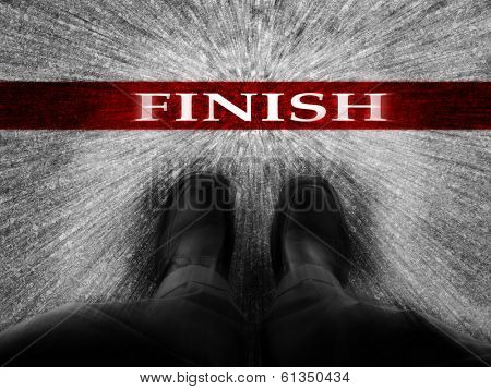 Speedy Finish line with businessman wearing dress shoes as metaphor for finishing work as a winner