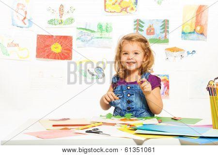 Smiling Girl Busy Gluing