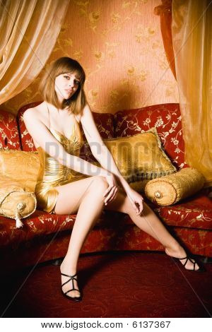 Sexy Young Woman In Short Golden Dress
