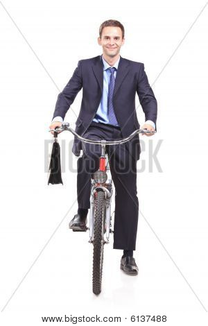 Young businessman on a bicycle