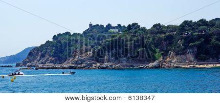 Seascape Panorama Near Lloret De Mar, Costa Brava, Spain. Fast Moving Boat In Frame.