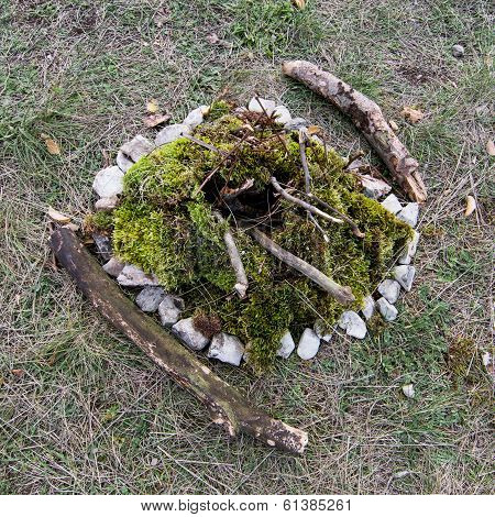 Extinct Campfire Lined With Green Moss
