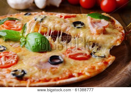 Tasty pizza on table close-up