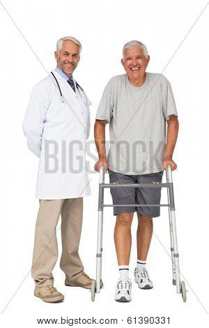 Full length portrait of a doctor with senior man using walker over white background