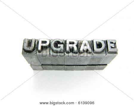Upgrade written in vintage letterpress blocks