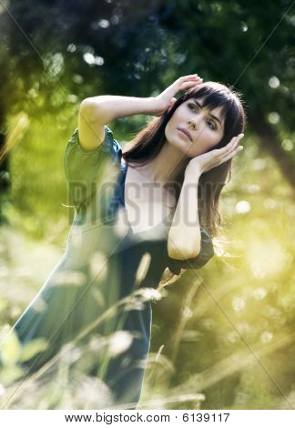 Young Beautiful Girl On A Meadow