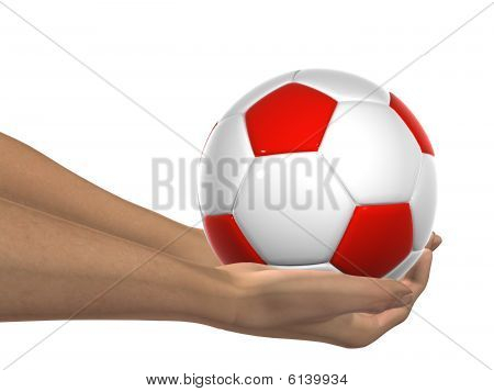 red and white 3D soccer ball held in hands