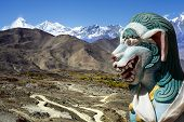 pic of mountain lion  - Ancient lion sculpture in himalaya mountains in Nepal - JPG