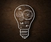 pic of cogwheel  - Conceptual image of light bulb and business strategy sketch - JPG