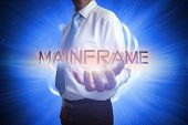 picture of mainframe  - Businessman presenting the word mainframe against background with shiny ball - JPG