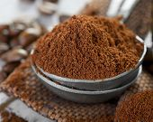 picture of coffee grounds  - Ground coffee in a metal spoon  - JPG