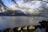 stock photo of annecy  - Large view of Annecy lake and snowed mountains on winter time France - JPG
